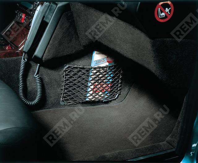 Сетка-карман в пространстве для ног переднего пассажира B67650000
