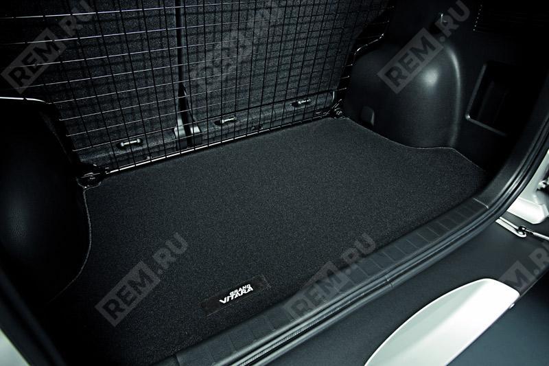 Ковер в багажник текстильный DLX 990E065J43000